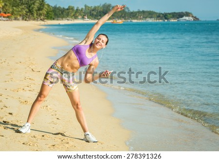 Beautiful fit female fitness model training and working out outside in summer at part of healthy lifestyle. - stock photo