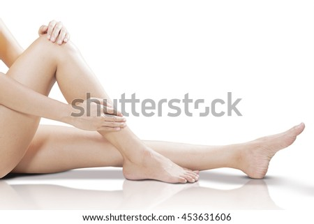Beautiful fit long female legs, isolated on white  background