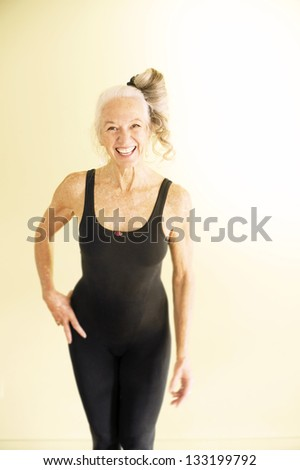 Beautiful fit mature woman laughing.