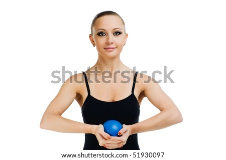 Beautiful fit red girl working out with blue ball