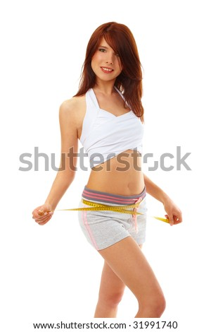 Beautiful fit woman with measure tape isolated over white. Weight loss and healthy lifestyle concept.