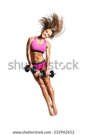 beautiful fitness female posing on studio background - stock photo