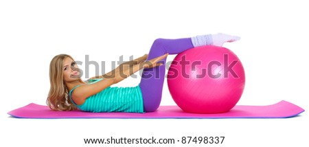 Beautiful fitness girl and boll isolated on white
