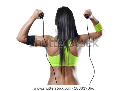 beautiful fitness woman jumping rope  isolated on white - stock photo