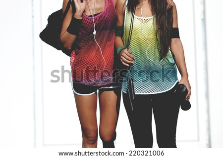 beautiful fitness woman returning from the gym, outdoor shot - stock photo