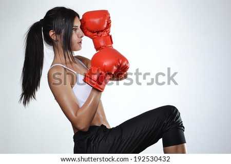 beautiful fitness woman with red boxing gloves  - stock photo