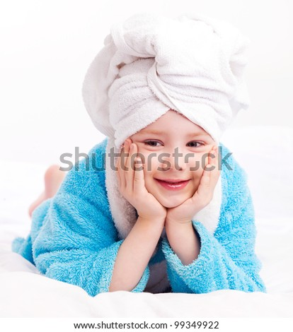 beautiful five year old girl  after the shower on the bed at home - stock photo