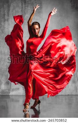beautiful flamenco dancer posing on a studio background - stock photo