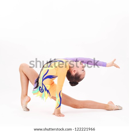 Beautiful flexible girl gymnast  over white background - stock photo