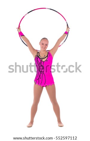 Beautiful flexible girl gymnast staying arms up with hoop over white background
