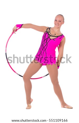 Beautiful flexible girl gymnast with hoop over white background