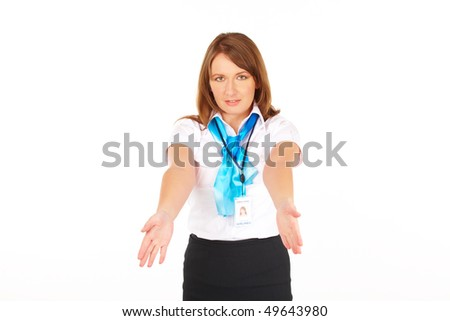 Beautiful flight attendant or stewardess presenting emergency exits and other safety instructions - stock photo