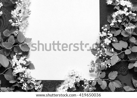 beautiful floral branches on a background of textured paper and dark fabric