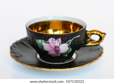 Beautiful floral vintage cup with plate isolated
