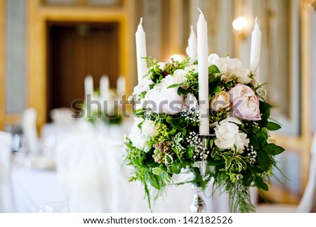 Beautiful floral wedding table decoration at wedding reception - stock photo