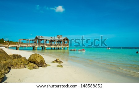 Beautiful Florida Keys beach with covered pier along the shoreline. - stock photo