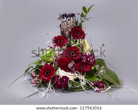 Beautiful flower arrangements for winter, spring, summer and autumn with colored backgrounds of red, purple and wintry white - stock photo