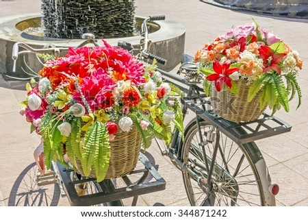 Beautiful Flower basket on vintage bicycle. - classic bike
