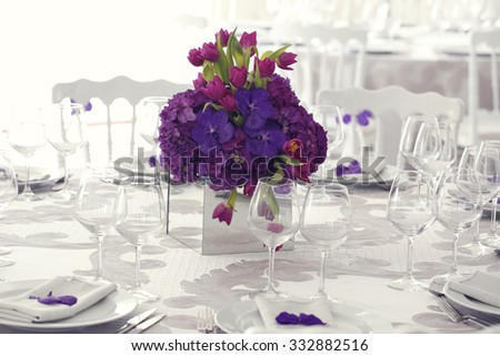 Beautiful flower bouquet decoration on wedding table - stock photo