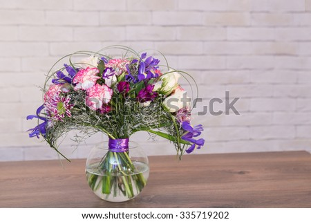 Beautiful flower bouquets on a light background of a brick