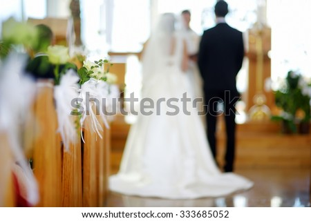 Beautiful flower wedding decoration in a church during catholic wedding ceremony  - stock photo