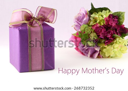 Beautiful flowers and elegant gift box in horizontal format for Mother's Day - stock photo