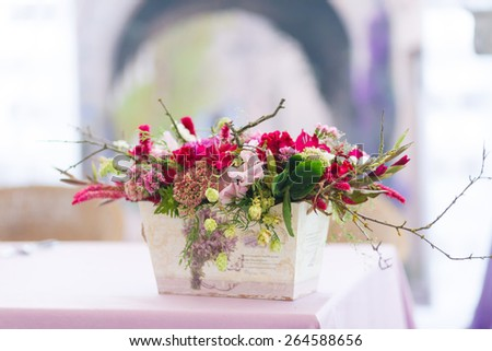 Beautiful flowers bouquets decor in vase close-up - stock photo