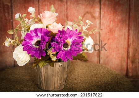 Beautiful flowers in a vase, vintage style. - stock photo