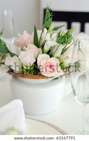 Beautiful flowers in white teapot