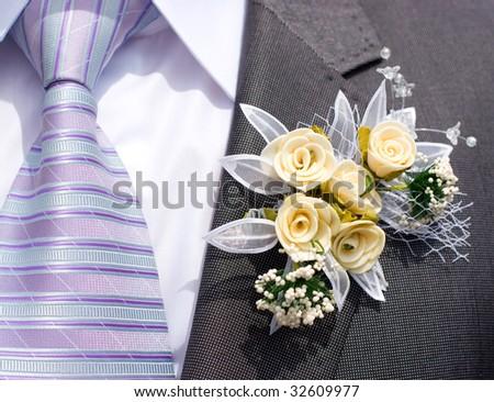beautiful flowers on lapel of male - stock photo