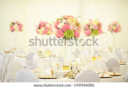Beautiful flowers on table - stock photo