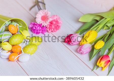 Beautiful flowers with easter egg decorations - stock photo