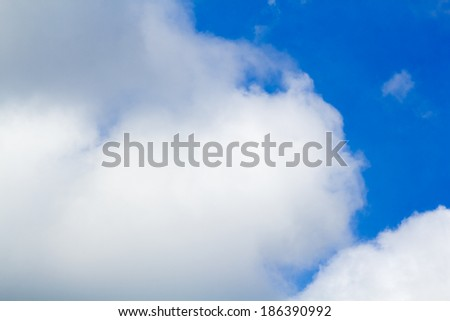 Beautiful, fluffy, white and grey clouds and blue sky