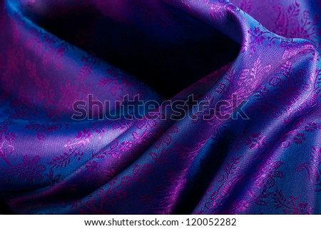 Beautiful folds of blue purple drape with ornament