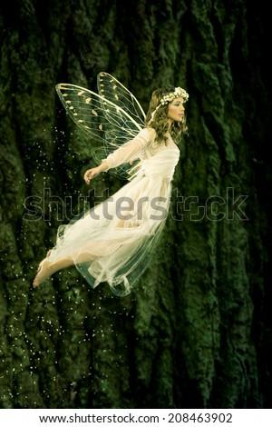 Beautiful forest fairy in flight - stock photo