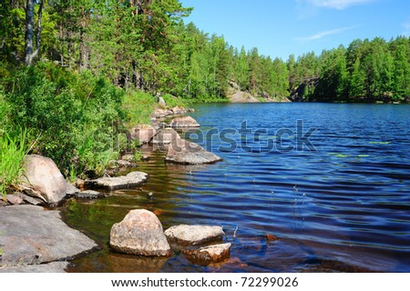 Beautiful forest lake in Finland - stock photo
