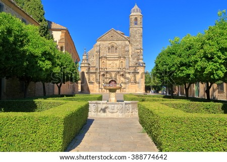 Beautiful fountain and distant building of El Salvador chapel in Ubeda, Jaen, Andalusia, Spain
