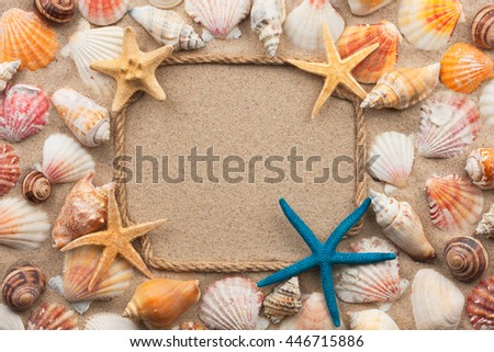 Beautiful frame of rope and seashells and starfish on the sand, with place for your image, text - stock photo