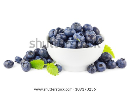 Beautiful fresh blueberries in a white bowl on a white background