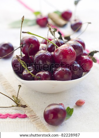 beautiful fresh cherry in a bowl. Selective focus - stock photo