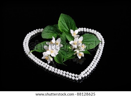 Beautiful Fresh Jasmine Flower and Reflection over Black with Heart of Pearl - stock photo