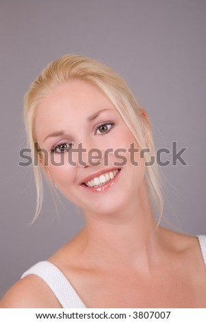 Beautiful fresh woman with a radiant smile - stock photo