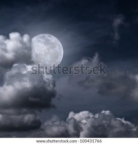 Beautiful full moon behind fantasy cloudy sky - stock photo