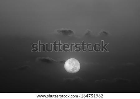 Beautiful full moon in a cloudy night - stock photo