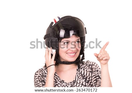 beautiful fun happy young girl wearing a helmet pointing up isolated on white - stock photo