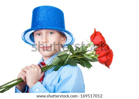 Beautiful funny boy wearing a shirt, a tie and a blue hat holding a bouquet of red roses smiling  (Mother's day gift concept)  - stock photo
