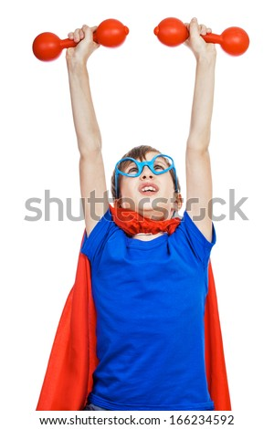 Beautiful funny child dressed as superhero working hard with small dumbbells (fitness concept) - stock photo