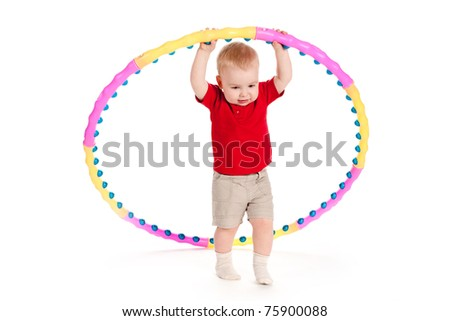 beautiful funny child plays with hoop - stock photo