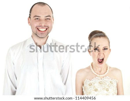 Beautiful funny wedding couple over white background - stock photo