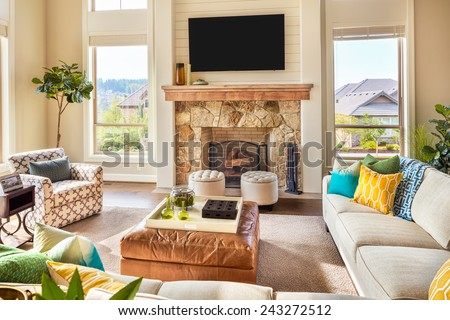 Beautiful Furnished Living Room Interior in New Luxury Home with Fireplace and Television - stock photo